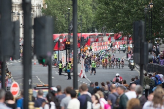 Th peloton approaches one of the feed zones during the Prudential RideLondon Classique, a 66 km road race in London on July 30, 2016 in the United Kingdom. ©Velofocus